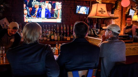 Patrons at the Capitol Lounge, close to the US Capitol, watch television coverage as the House prepares to vote on impeachment.