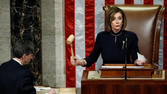 House Speaker Nancy Pelosi of Calif., strikes the gavel after announcing the passage of article II of impeachment against President Donald Trump, Wednesday, Dec. 18, 2019, on Capitol Hill in Washington.