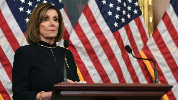 US Speaker of the House Nancy Pelosi holds a press conference after the House passed Resolution 755, Articles of Impeachment Against President Donald J. Trump, at the US Capitol in Washington, DC, on December 18, 2019. - The US House of Representatives voted 229-198 on Wednesday to impeach President Donald Trump for obstruction of Congress. The House impeached Trump for abuse of power by a 230-197 vote. The 45th US president is just the third occupant of the White House in US history to be impeached.