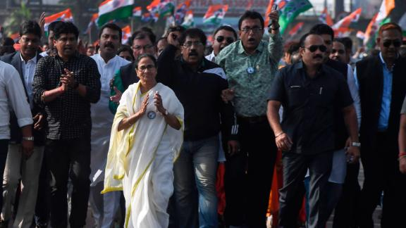Chief minister of West Bengal state and leader of the Trinamool Congress Mamata Banerjee, along with party supporters, walks in a mass rally across Howrah bridge in Kolkata on December 18.