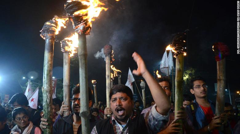 Protestors participate in a torch rally in Kolkata on December 17.
