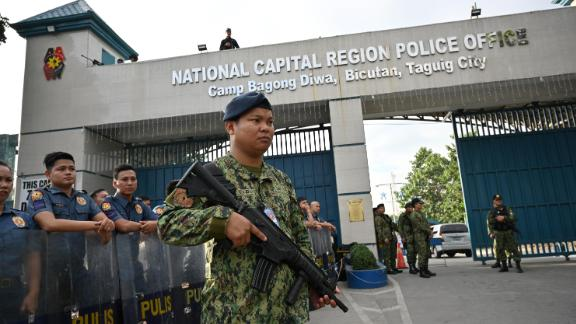 Members of the police special action force stand guard at a gate of the capital command headquarters in Manila on December 19, 2019.