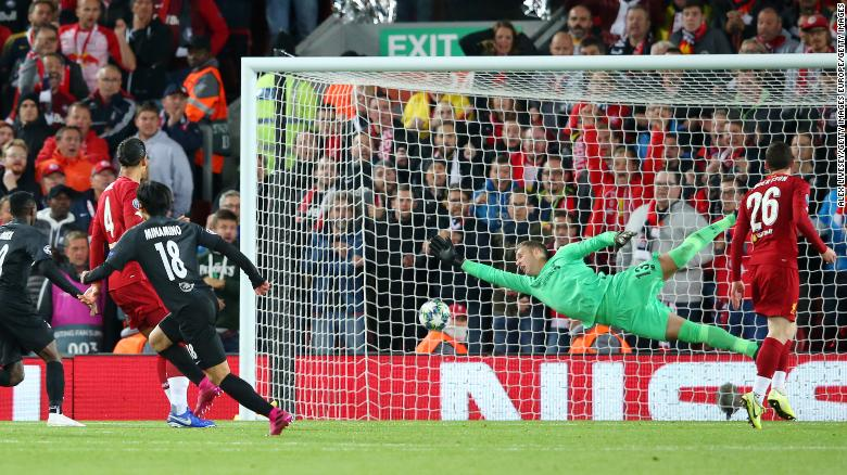 Minamino scores his side's second goal against Liverpool in the Champions League.