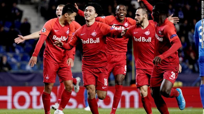 Minamino celebrates after scoring against KRC Genk.