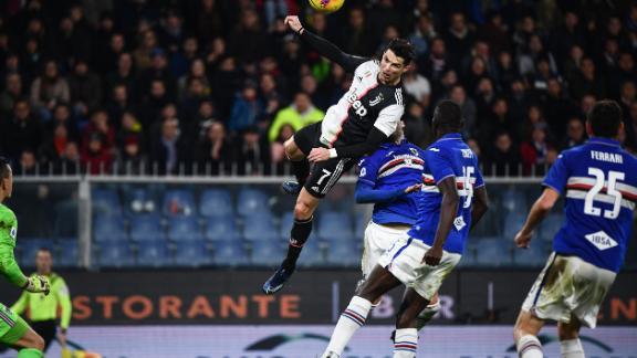 Ronaldo rises above the Sampdoria defence to score for Juventus.