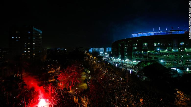 Demonstrators gather during a protest outside the Camp Nou during El Clasico.