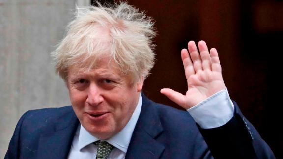Britain's Prime Minister Boris Johnson waves as he leaves Downing Street for the State Opening of Parliament by Queen Elizabeth II, in the House of Lords at the Palace of Westminster in London, Thursday, Dec. 19, 2019.(AP Photo/Frank Augstein)