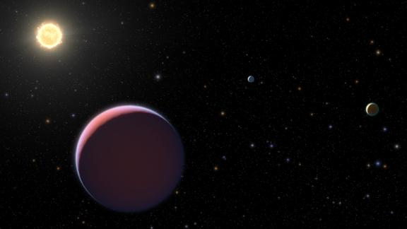 "This artist's illustration of the Kepler 51 system shows newly discovered super-puff exoplanets, which are also called ""cotton candy"" exoplanets because they're so lightweight."