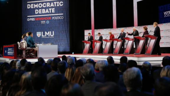 Presidential candidates Andrew Yang, Pete Buttigieg, Elizabeth Warren, Joe Biden, Bernie Sanders, Amy Klobuchar and Tom Steyer participate in the Democratic debate co-hosted by Politico and PBS Newshour in Los Angeles, California, on Thursday, December 19.