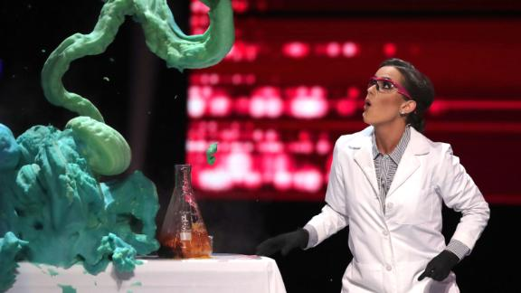 Camille Schrier performs a science experiment prior to winning the Miss America competition Thursday night at the Mohegan Sun casino in Uncasville, Conn.