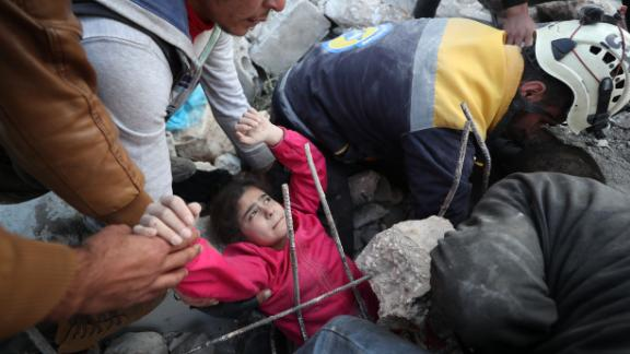 EDITORS NOTE: Graphic content / Members of the Syrian Civil Defence, also known as the White Helmets, recover a  wounded girl from the rubble of a building following a reported Russian air strike in the village of Tal Mardikh in Syria's northwestern Idlib province on December 19, 2019. (Photo by Omar HAJ KADOUR / AFP) (Photo by OMAR HAJ KADOUR/AFP via Getty Images)