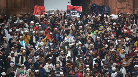Protesters gather by the Jama Masjid mosque in New Delhi to demonstrate against India