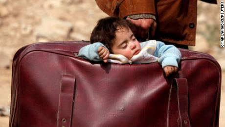 "A child sleeps in a bag in the village of Beit Sawa, eastern Ghouta, Syria, March 15, 2018. Picture taken March 15, 2018. REUTERS/Omar Sanadiki/File Photo   SEARCH ""POY DECADE"" FOR THIS STORY. SEARCH ""REUTERS POY"" FOR ALL BEST OF 2019 PACKAGES. TPX IMAGES OF THE DAY."