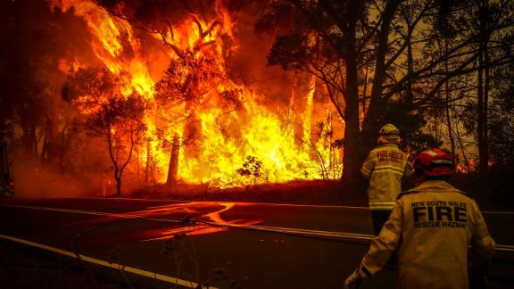Fire and rescue personnel monitor a bushfire as it burns near homes on the outskirts of Bilpin on Thursday, December 19.