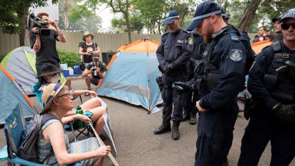 Police disperse demonstrators during a climate protest near Australian Prime Minister Scott Morrison