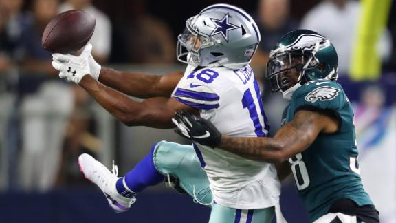 Randall Cobb of the Dallas Cowboys attempts to make a catch against Orlando Scandrick of the Philadelphia Eagles during the first half in the game at AT&T Stadium on October 20, 2019 in Arlington, Texas.
