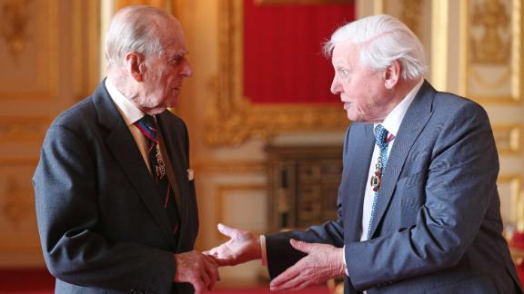 Prince Philip speaks with Sir David Attenborough ahead of an Order of Merit luncheon in May 2019.