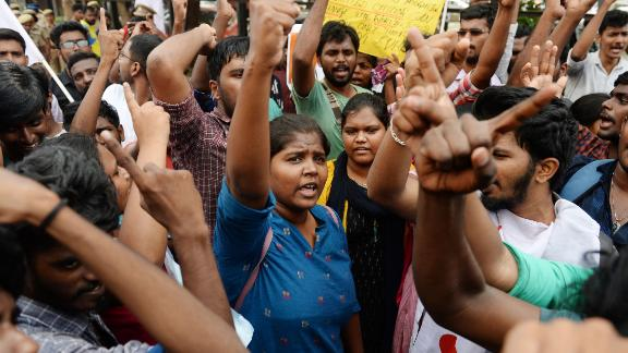People take part in a protest against India