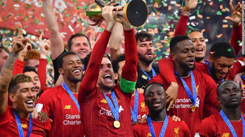 Liverpool captain Jordan Henderson lifts the Club World Cup trophy after his side's 1-0 extra time victory over Flamengo in Qatar.