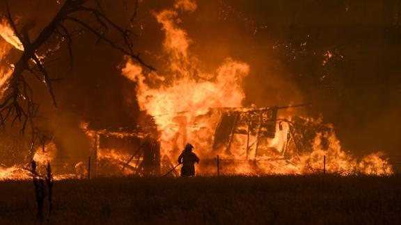 A firefighter battles the Gospers Mountain Fire in Bilpin, New South Wales, on Saturday, December 21.