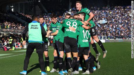 Atalanta players celebrate Josip Ilicic's goal in their 5-0 defeat of AC Milan.