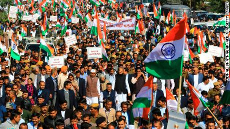 Rajasthan Chief Minister Ashok Gehlot (C) along with congress party leaders, workers and supporting parties takes part in a march against India's new citizenship law in Jaipur on December 22, 2019.