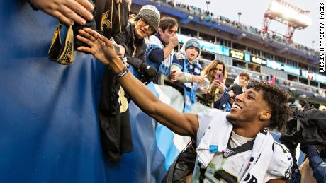 Michael Thomas shakes hands with fans after a game against the Tennessee Titans at Nissan Stadium on December 22, 2019.