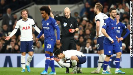 Son Heung-Min reacts to receiving a red card during Tottenham's defeat.