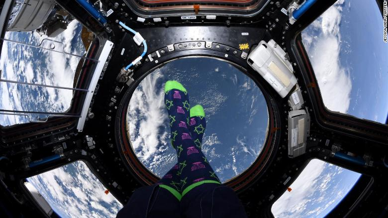 Astronaut Jessica Meir shows off her Hanukkah socks from the International Space Station.