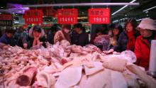 China cuts some tariffs to boost trade and remove heat from pork prices