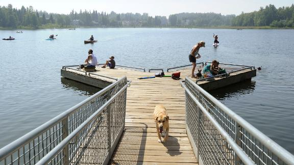 Alaskans who routinely pack knit caps and fleece jackets in summer were swapping them for sunscreen and parasols at DeLong Lake amid a prolonged heatwave.
