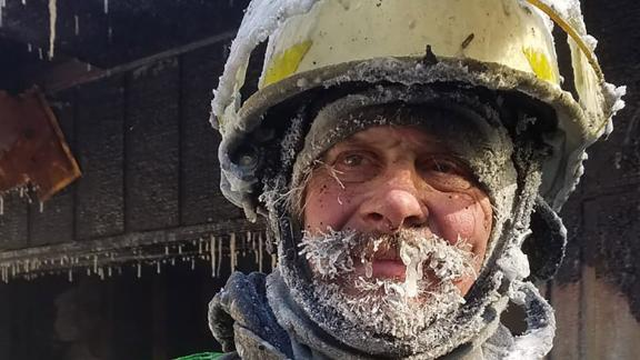 Assistant Chief Bimbo Gifford after battling a fire in freezing temperatures.