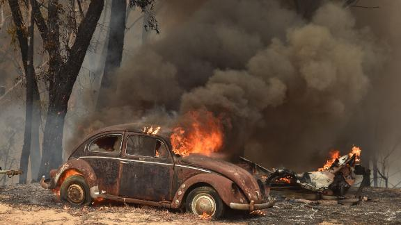 An old Beetle burns from bushfires in Balmoral, 150 kilometres southwest of Sydney.