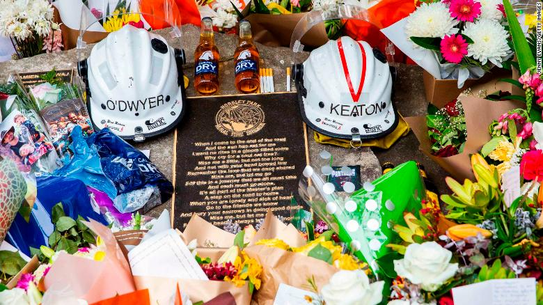 Tributes for volunteer firemen Andrew O'Dwyer and Geoffrey Keaton at Horsley Park Rural Fire Brigade in Sydney, Australia, on Sunday, December 22. It's believed their vehicle hit a tree before rolling off the road, the New South Wales Rural Fire Service said in a statement.