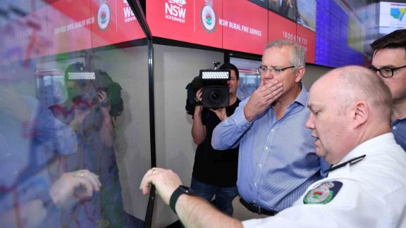 Australian Prime Minister Scott Morrison is briefed by fire officials at New South Wales Rural Fire Service control room in Sydney on December 22. Morrison arrived back in Sydney amid criticism after taking a family holiday to Hawaii during the bushfire emergency.