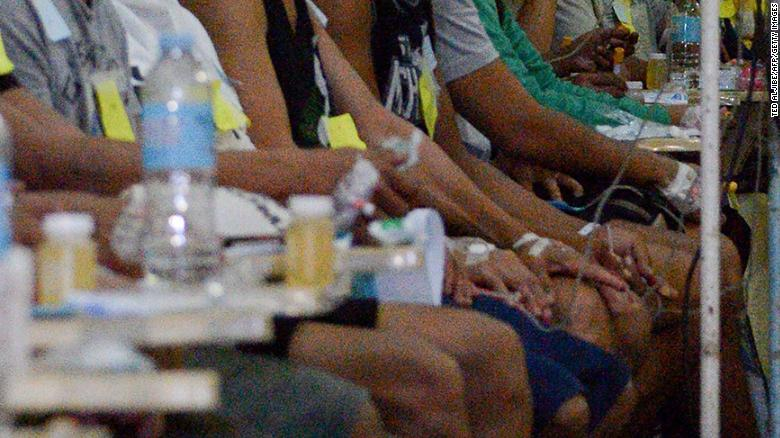 Victims who fell ill after drinking lambanog wait for treatment at the Philippine General Hospital in Manila on December 23, 2019.
