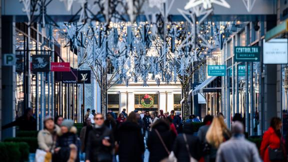 Holiday shoppers walk though a market in Washington, DC on December 15, 2019. (Photo by ANDREW CABALLERO-REYNOLDS/AFP via Getty Images)