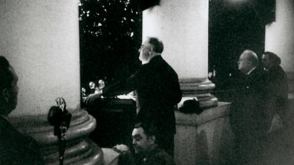 President Franklin D. Roosevelt and Prime Minister Winston Churchill on the South Portico of the White House during the National Christmas Tree Lighting ceremony, December 24, 1941.