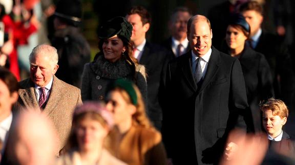 Britain's Prince William, center, and Kate, Duchess of Cambridge, center left, arrive with their son Prince George, center right.