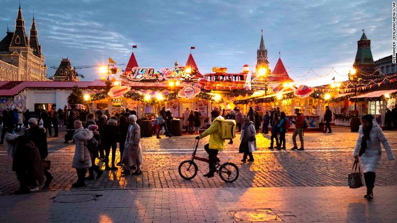 People walk at Holiday's Market on Red Square in Moscow on Friday, December 20.