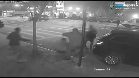 A still image from a surveillance video showing two men attacked and robbed for $1 in the Bronx on Christmas Eve.