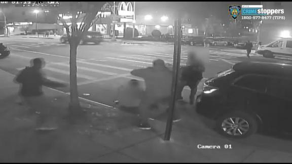 A still image from a surveillance video shows two men being attacked and robbed in the Bronx.