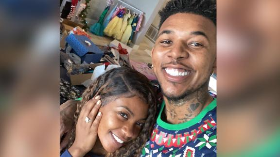 Nick Young and Keonna Green smile after getting engaged on Christmas.