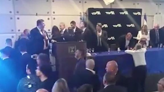 Benjamin Netanyahu is rushed off stage as a rocket is fired from Gaza into Israel