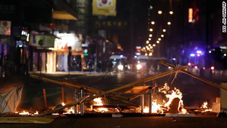 Debris burns on a street during the Christmas holidays in Hong Kong.