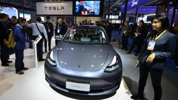 People watch Tesla Model 3 at Tesla booth on day three of the 2nd China International Import Expo (CIIE) at the National Exhibition and Convention Center on November 7, 2019 in Shanghai, China.