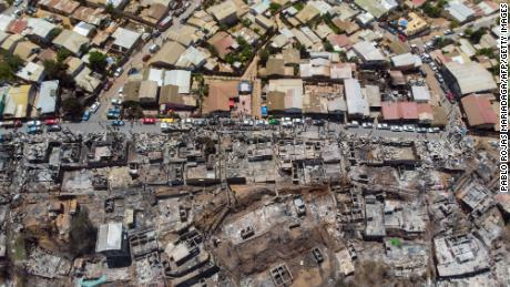 Aerial view of burnt houses after a forest fire in Valparaiso, Chile.