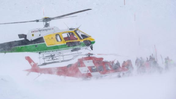 Rescue forces and helicopters search for missing people after an avalanche swept down a ski piste in the central town of Andermatt, canton Uri, Switzerland, Thursday, Dec. 26, 2019. The avalanche occurred mid-morning Thursday while many holiday skiers enjoyed mountain sunshine the day after Christmas. (Urs Flueeler/Keystone via AP)