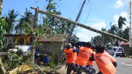 Workers pull a fallen electric pylon damaged at the height of Typhoon Phanfone in Salcedo town, in Eastern Samar province, on December 26.