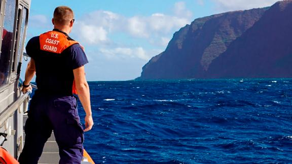 In this photo released by the U.S. Coast Guard, Coast Guard Cutter William Hart moves toward the Na Pali Coast on the Hawaiian island of Kauai on Friday.